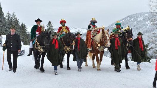 Austria Carol Singers Locals dressed as traditional carol singers ride on horses on Monday, Jan. 5, 2015 in Dienten, Austrian province of Salzburg. Traditionally carol singers walk from house to house around epiphany to collect money for poor children in other countries. (AP Photo/Kerstin Joensson)